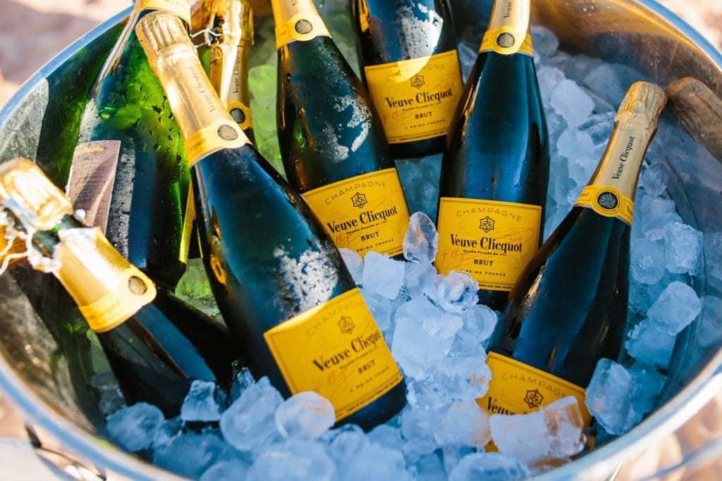 champagne bottles in bucket on Riddell Beach