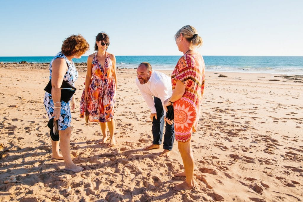 groom with wedding guests on Riddell Beach