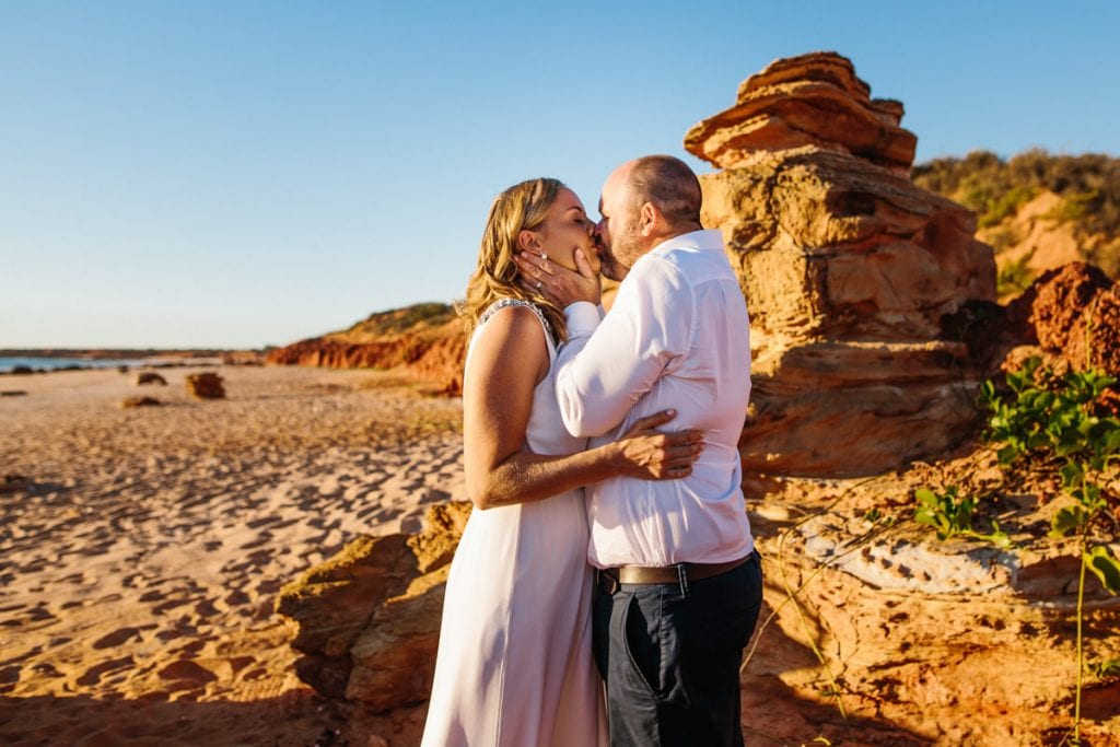 wedding couple kissing on Riddell Beach