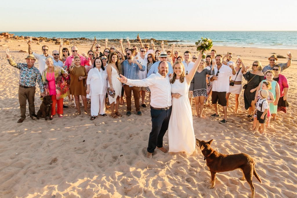 large group at beach wedding