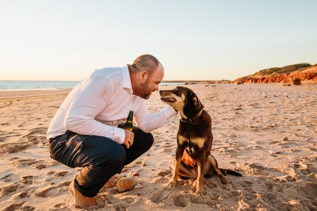 groom and his dog on Broome beach