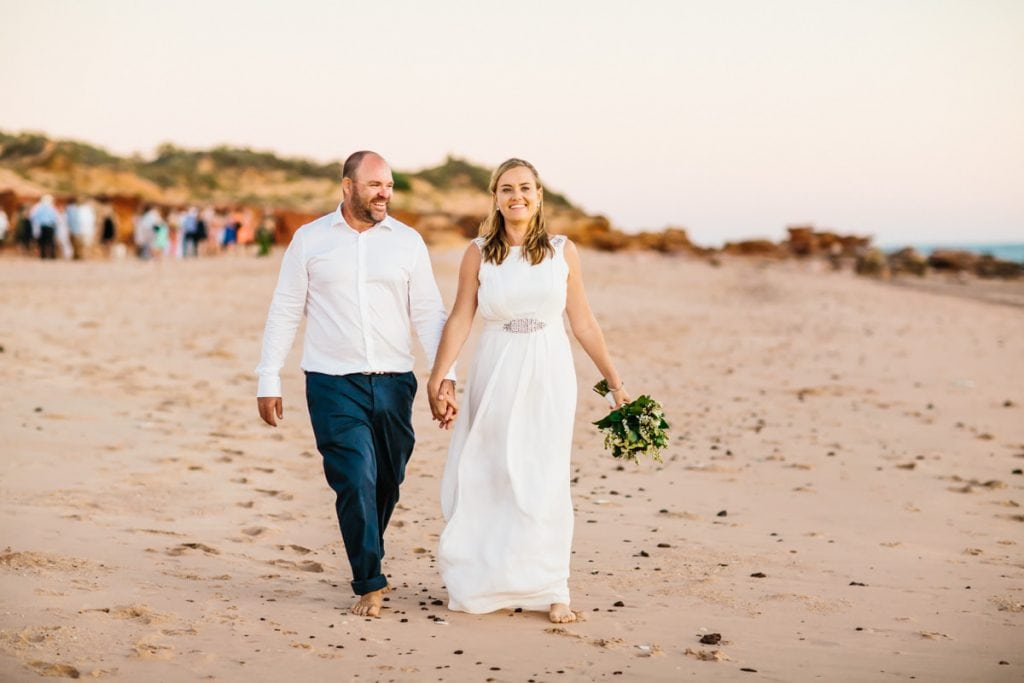 Broome wedding couple walking along Riddell Beach