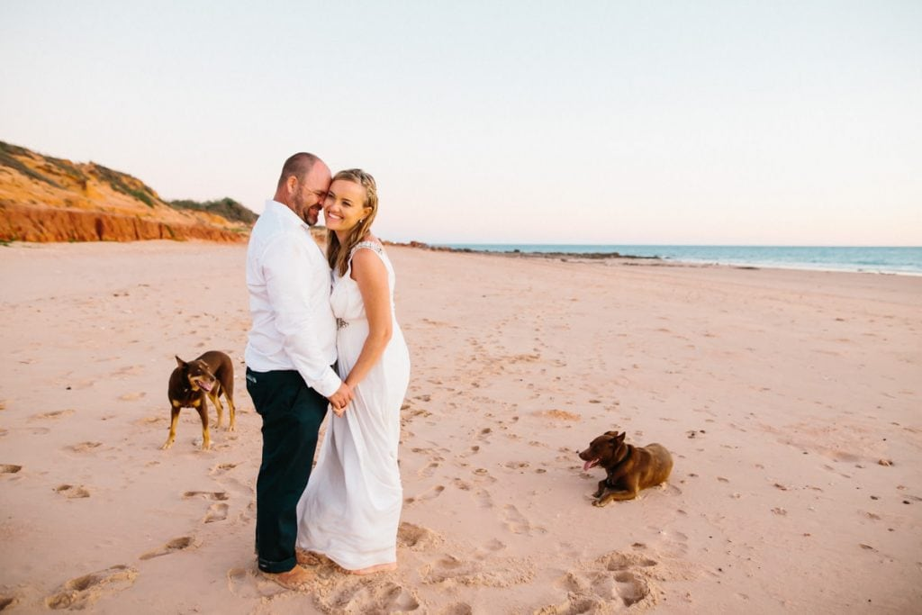 married young couple with dogs on beach