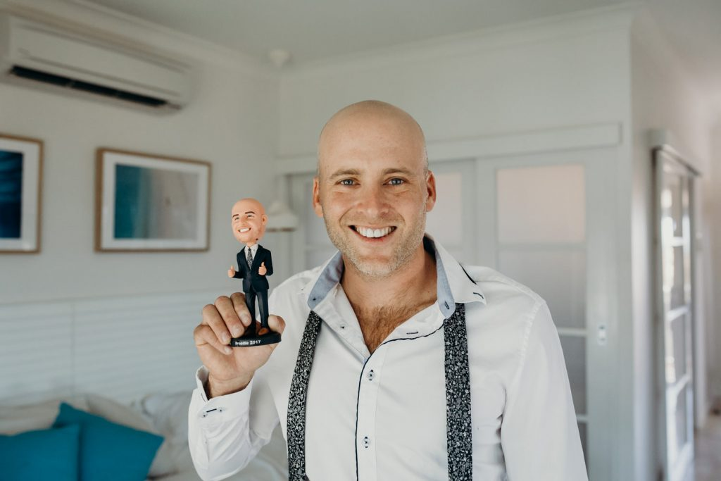 groom with bobble head