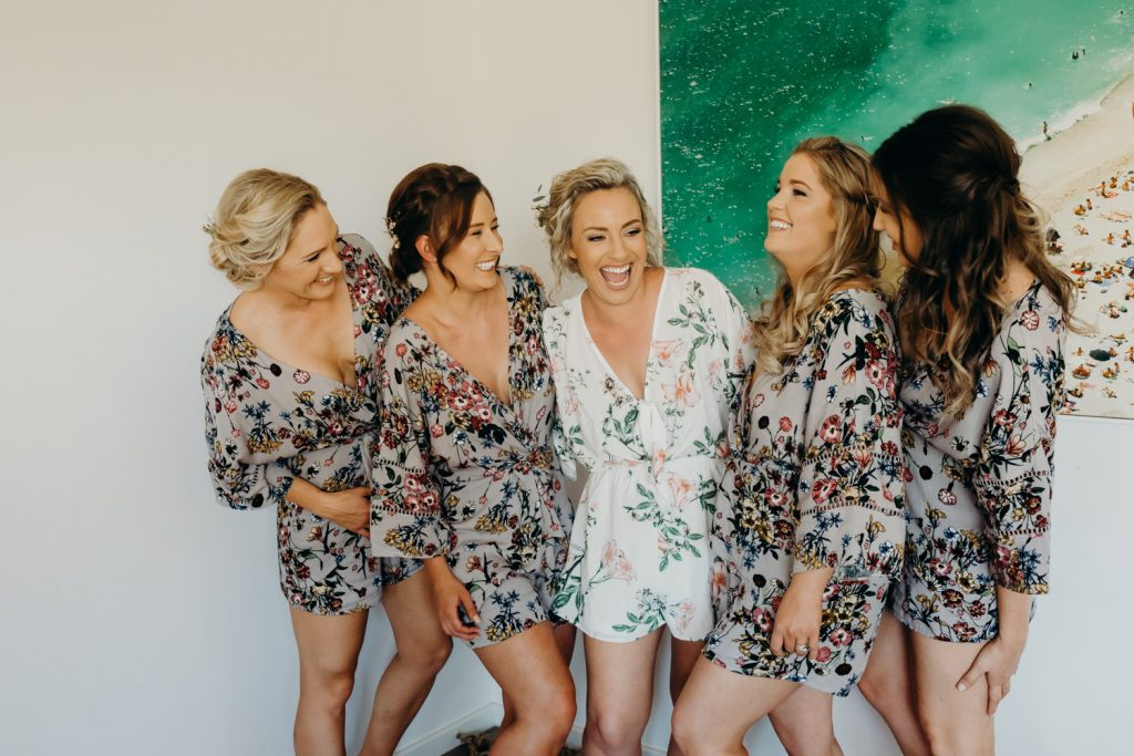 laughing bride with bridesmaids in getting ready robes at AirBnB in Broome