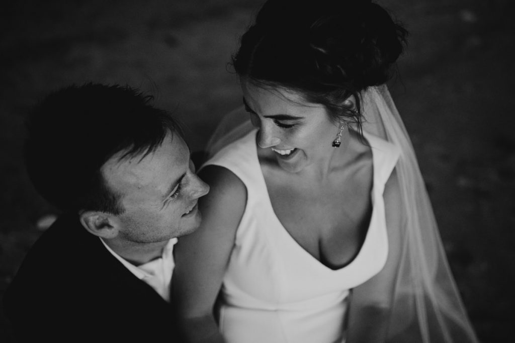 close up of young wedding couple looking at each other