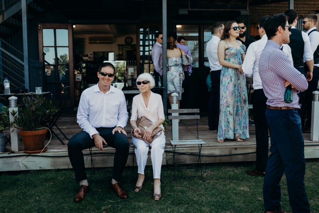 wedding guests sitting on chairs