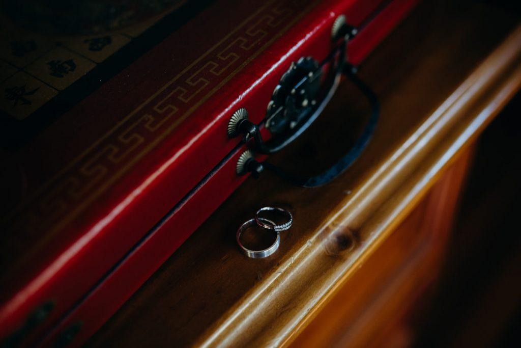 wedding rings on a bookshelf