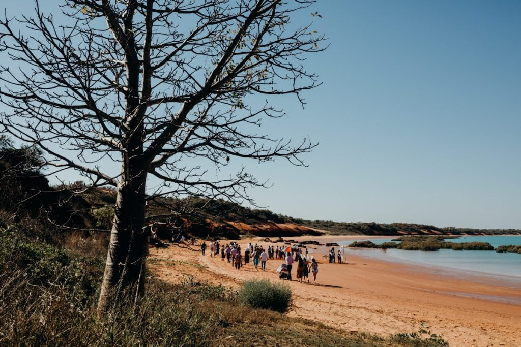 wedding guests making their way to ceremony at Roebuck Bay in Broome