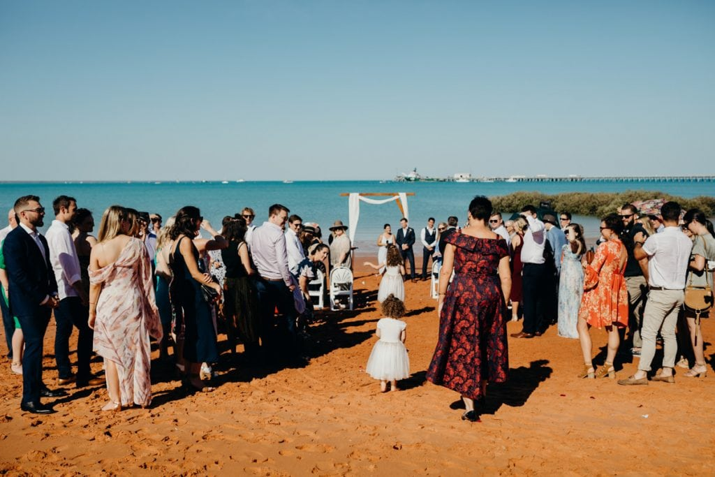 mother of the bride walks down the aisle at beach wedding at Roebuck Bay in Broome