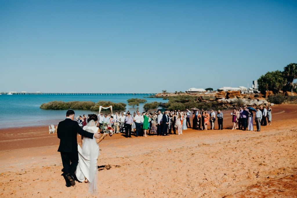 father and daughter at beach wedding at the shores of Roebuck Bay in Broome