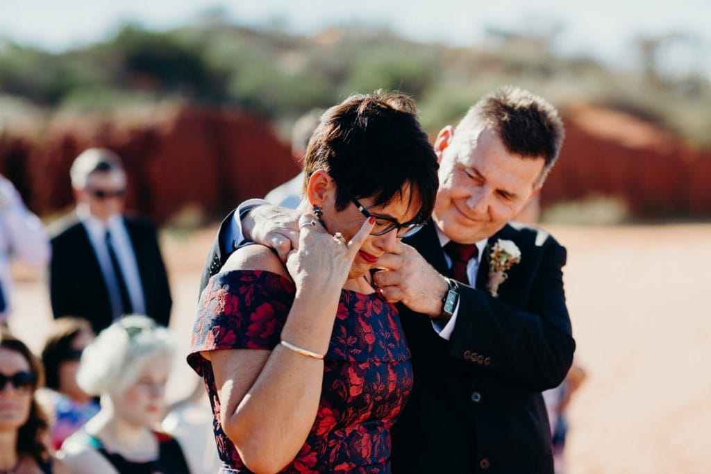 tears during the beach wedding ceremony by mother of the bride