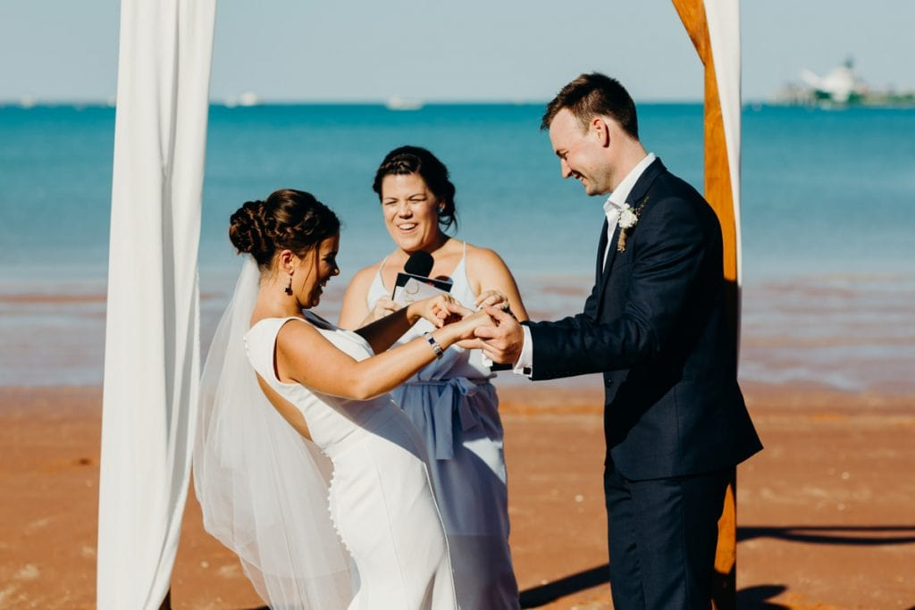 wedding couple exchanging rings at Broome wedding