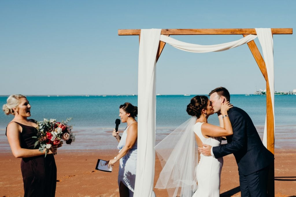 young wedding couple's first kiss at Roebuck Bay wedding in Broome