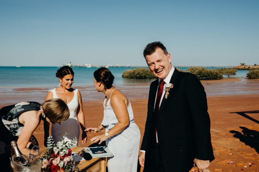 signing of documents on the beach at Roebuck Bay Broome wedding