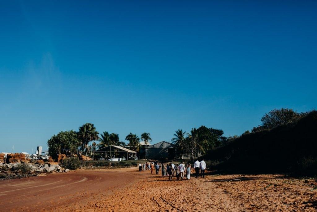 people walking towards the Broome Hovercraft Base at Roebuck Bay