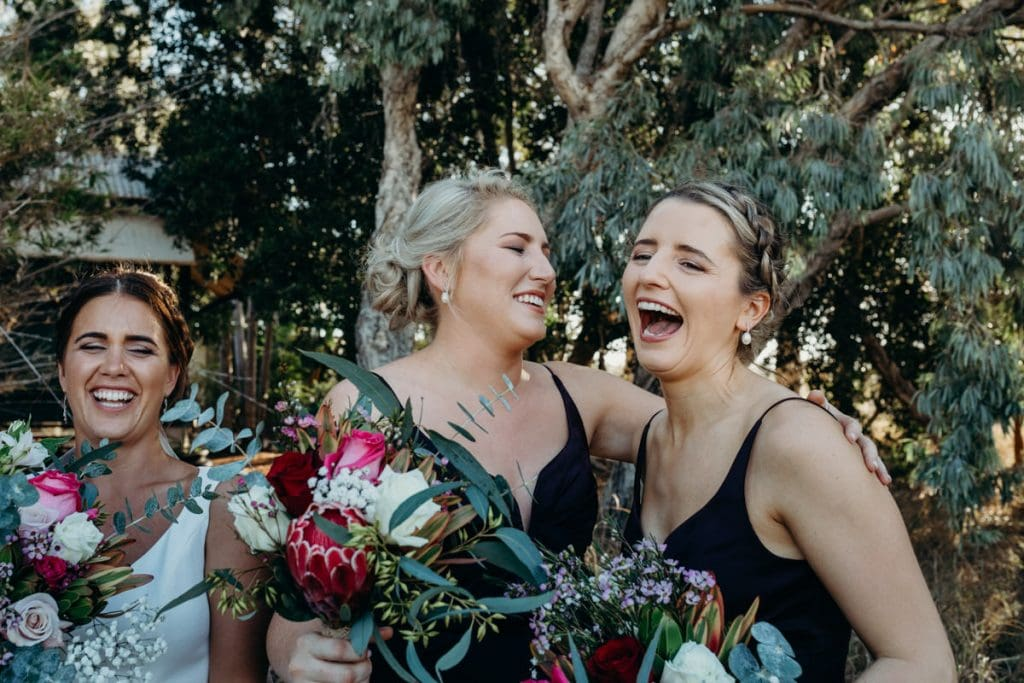 young women in bridal party laughing at joke
