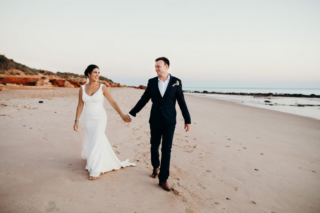 married coupled walking hand in hand on Broome beach
