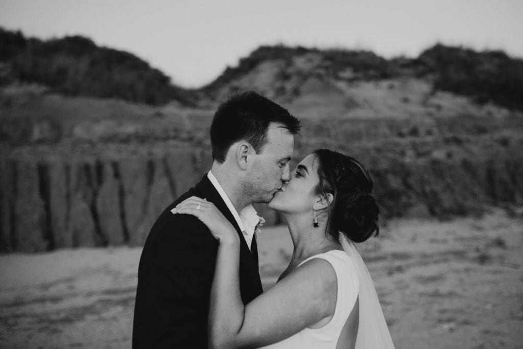 kissing wedding couple on Riddell Beach in Broome