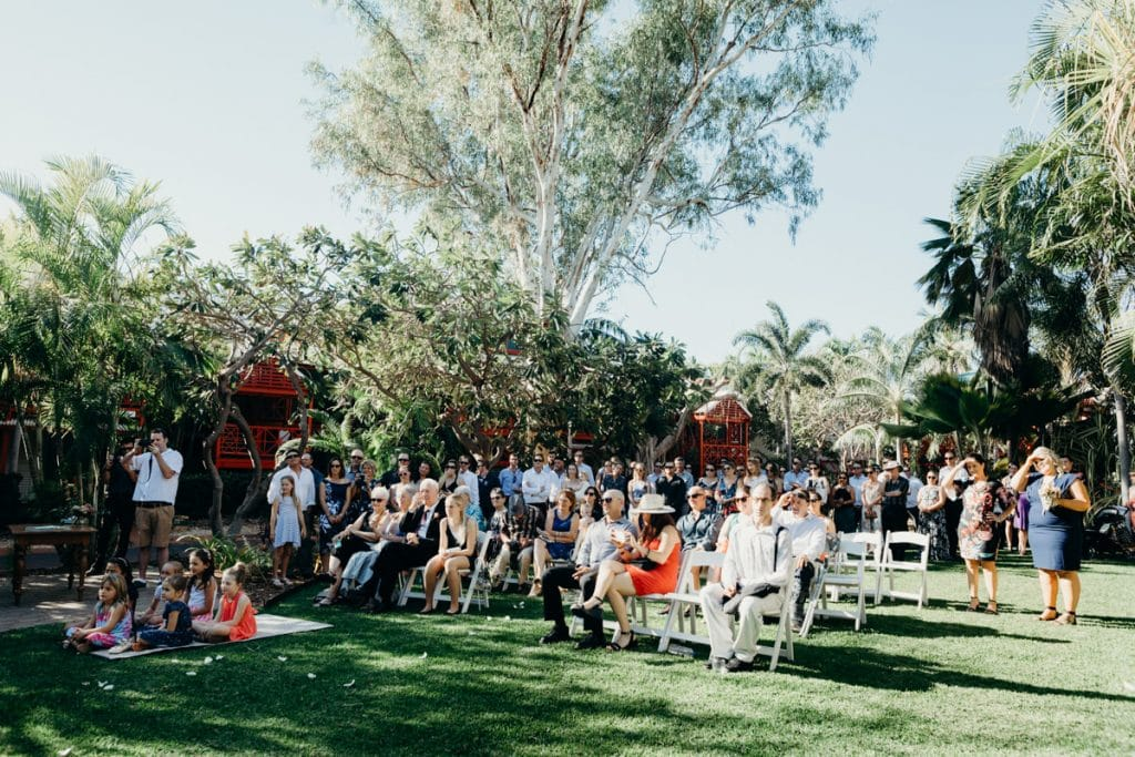 wedding guests are seated at Cable Beach Club gardens