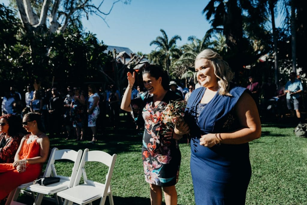 wedding guests standing in bright sun