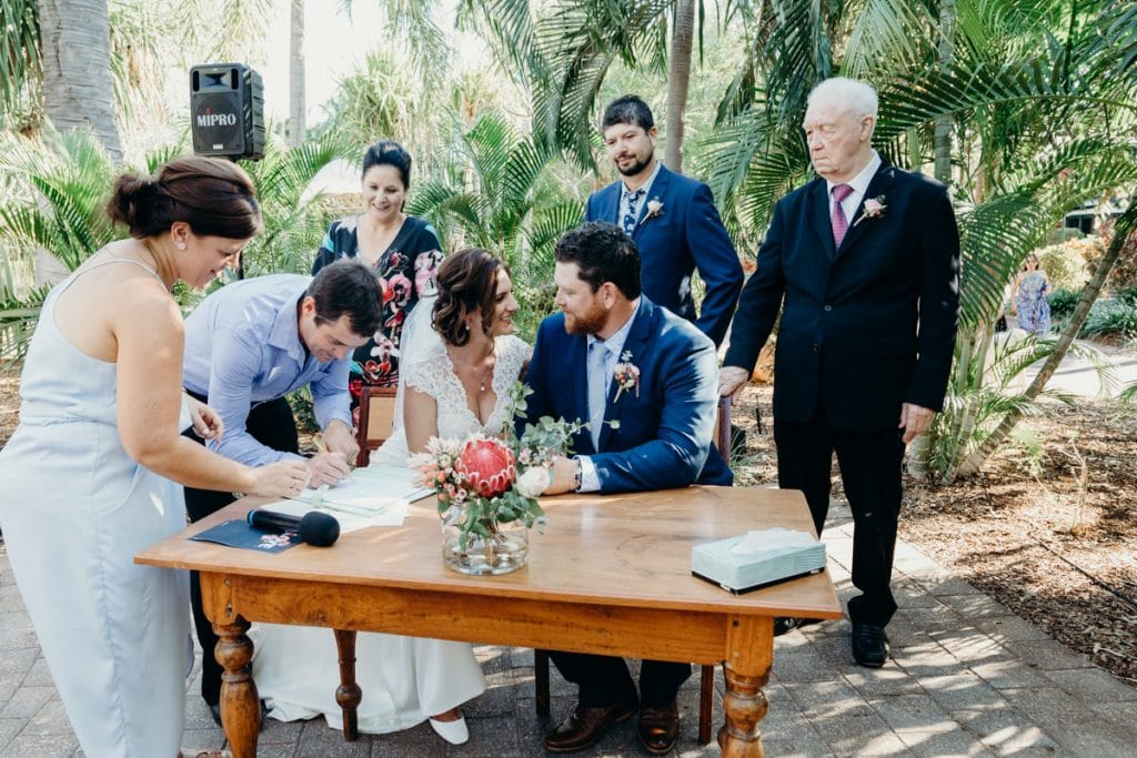 wedding certificate gets signed with Broome celebrant Elle Saunders