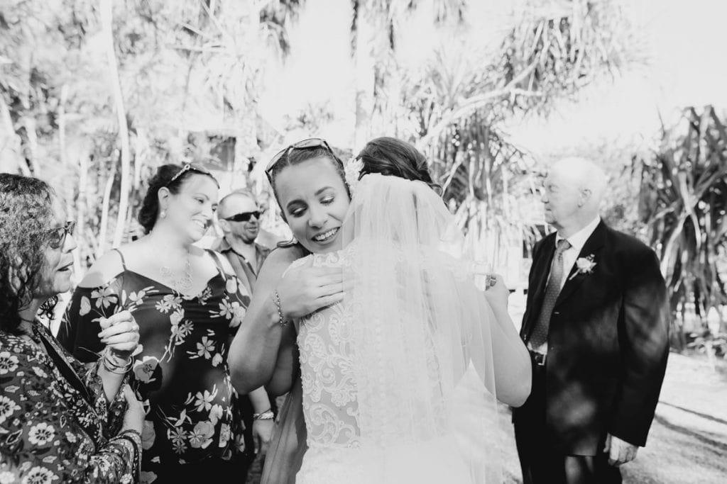 woman congratulates bride after wedding ceremony