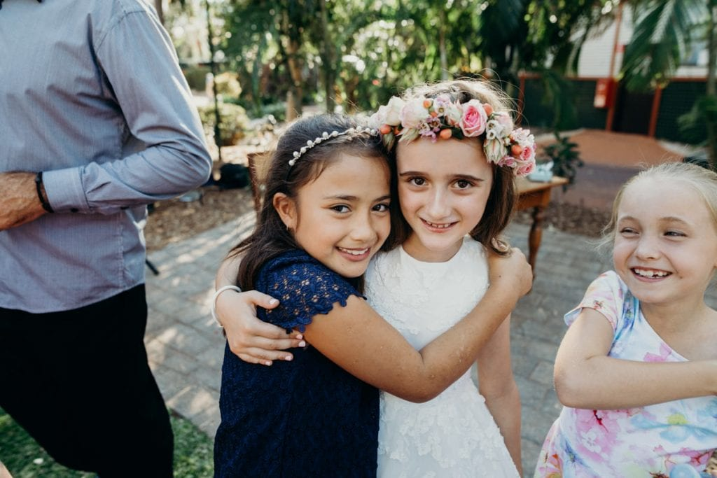 young girls hugging and smiling