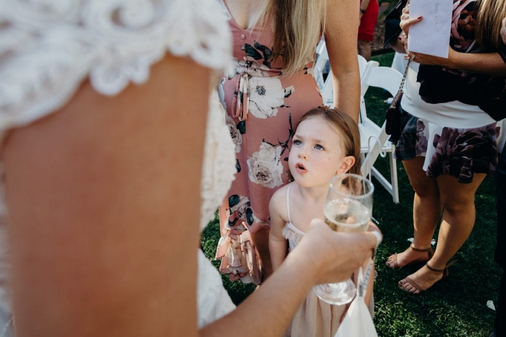 little girls looks at bride