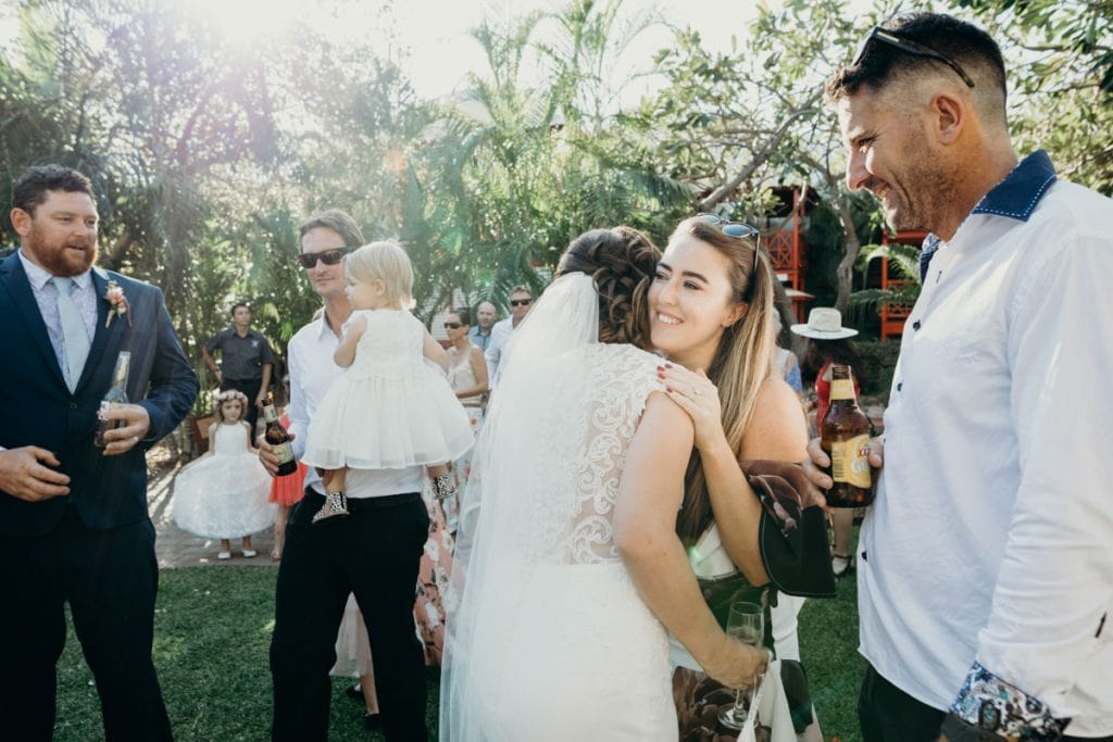 wedding guests congratulating the couple