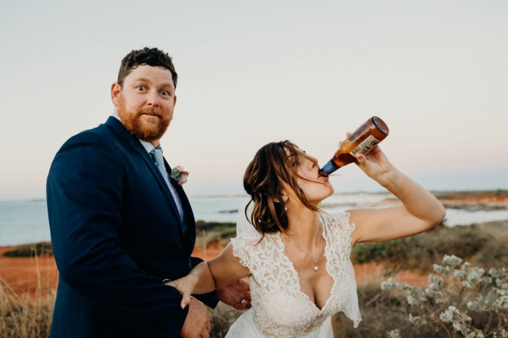 bride and groom having fun and drinking beer