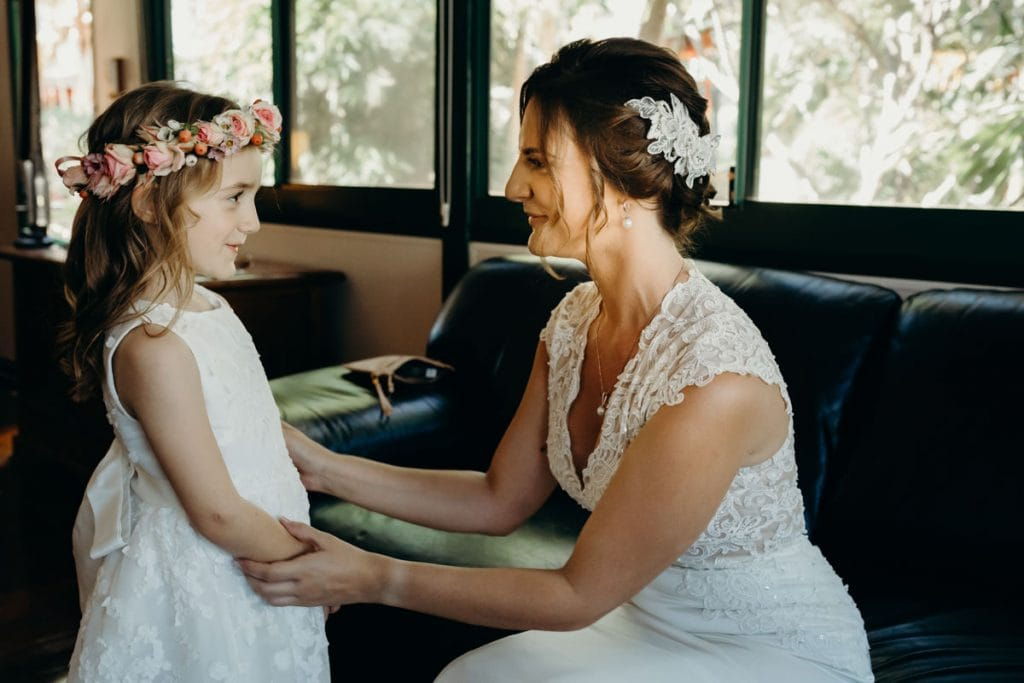 bride with her daughter as flower girl