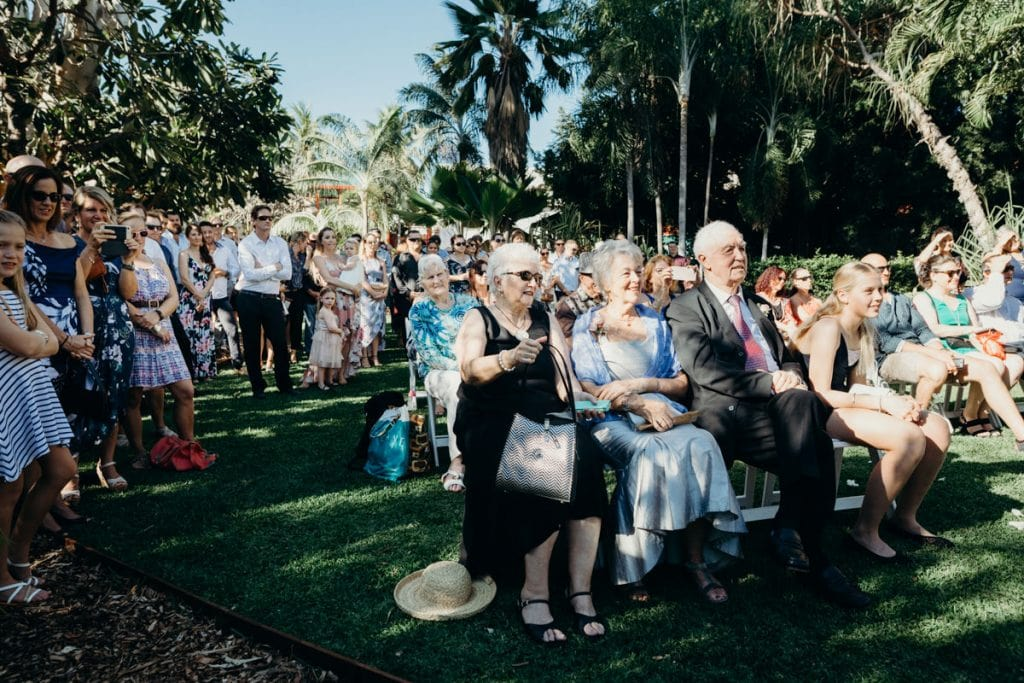 parents of the wedding couple seated in the first row at Lily Pond Lawn at Cable Beach Club