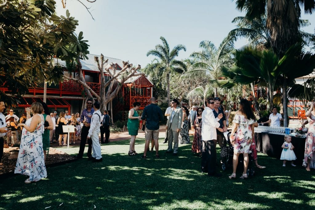 wedding guests mingling at Lily Pond Lawn at Cable Beach Club