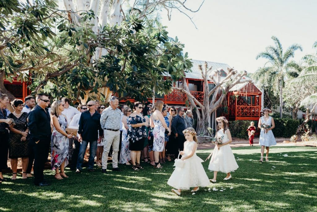 flower girls walking down the aisle at Cable Beach Club