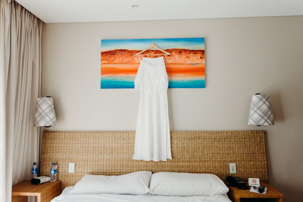 Grace Loves Lace wedding dress hung up in Broome hotel room