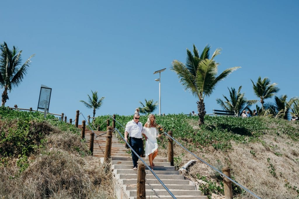 father of the bride walking his daughter down the stairs to Cable Beach wedding