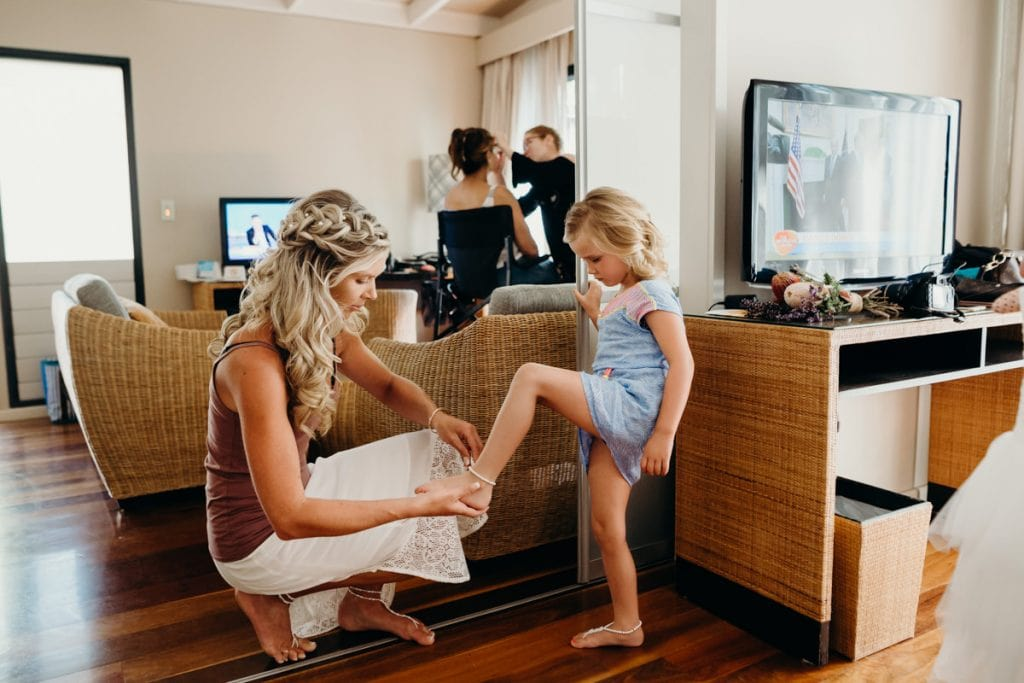 Bride and young daughter getting ready for Cable Beach wedding