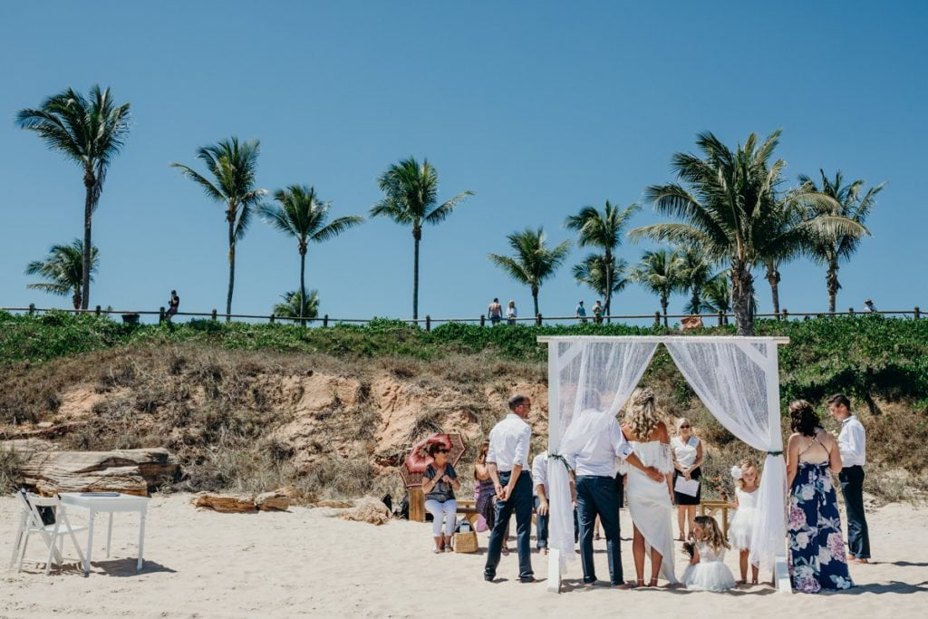 wedding ceremony on Cable Beach with palm trees in the background