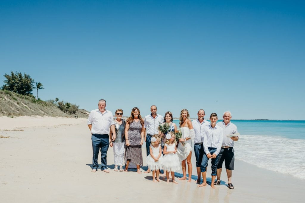 family photo on Cable Beach with bride and groom