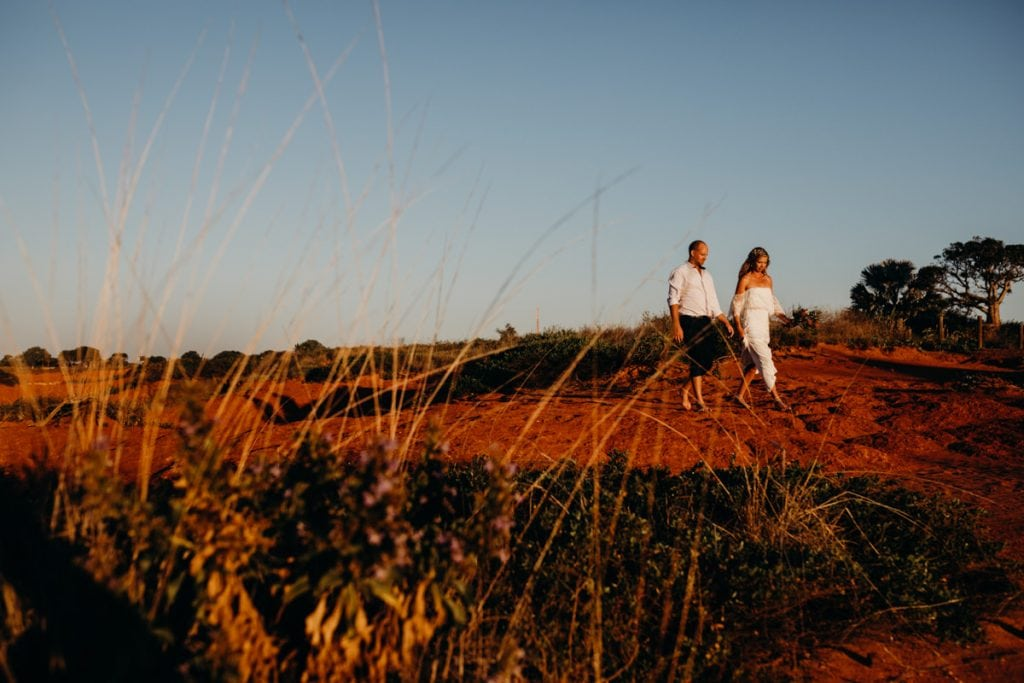 bride and groom walking along at Gantheaume Point with boab tree in background