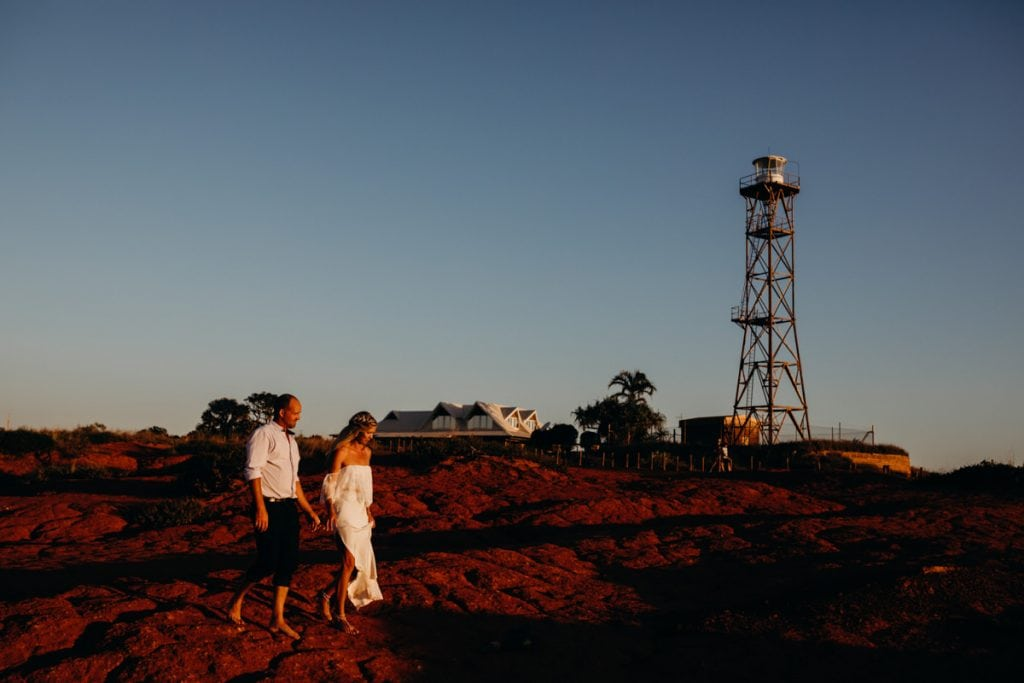 married couple walk in front of Gantheaume Point lighthouse in Broome