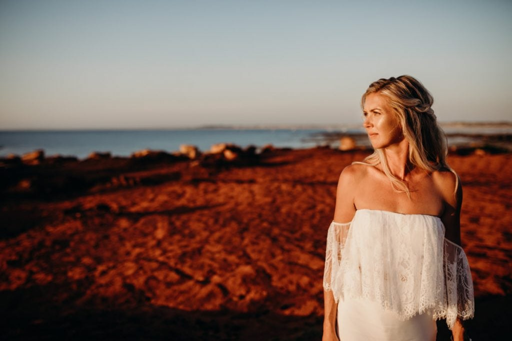 portrait of Broome bride at Gantheaume Point near Cable Beach wearing Grace Loves Lace wedding dress