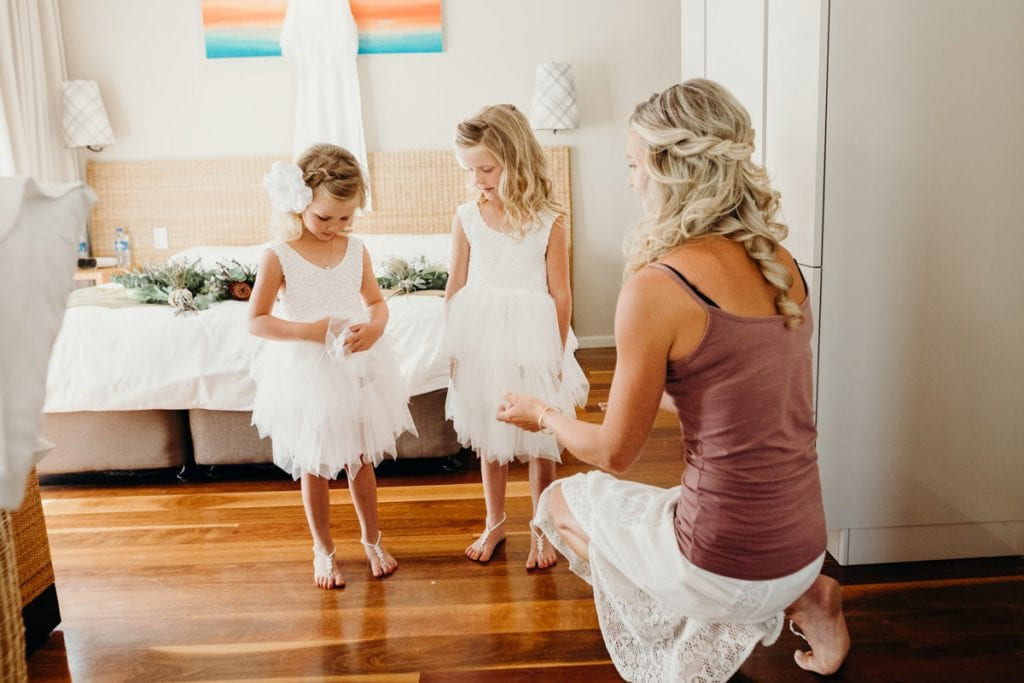 Bride and two young daughters getting ready for wedding