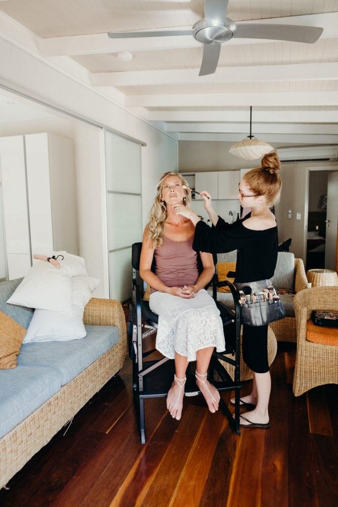 Broome makeup artist applying makeup to bride in Kimberley Sands Hotel room