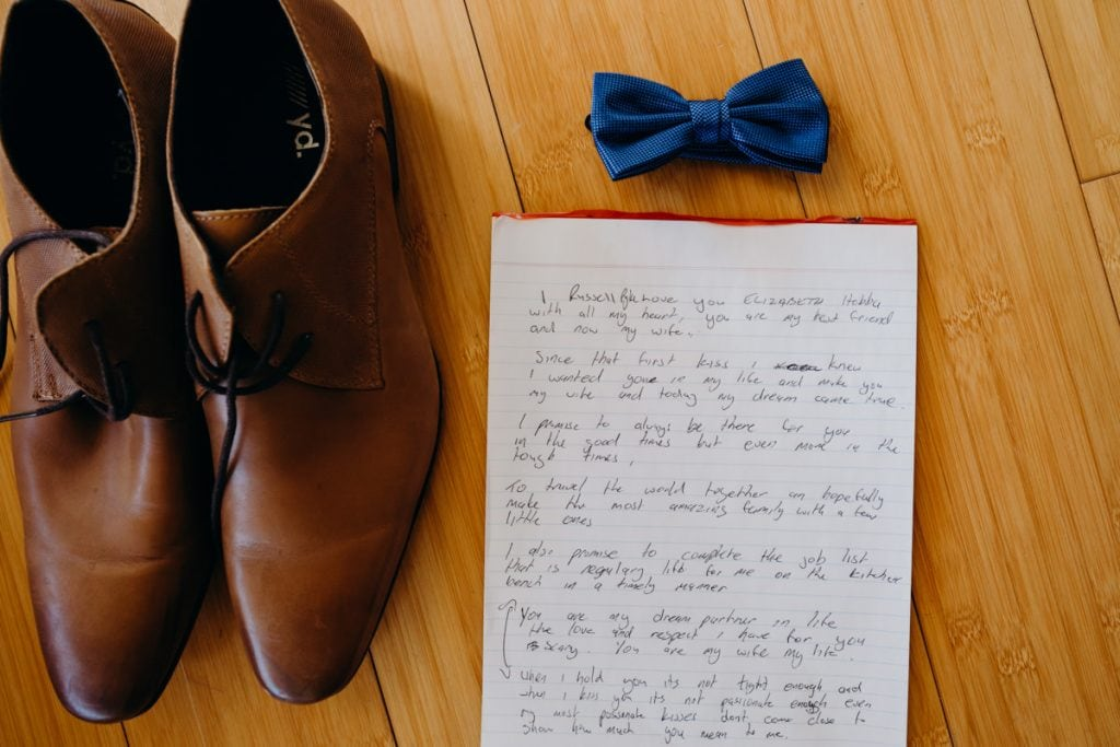 handwritten wedding vows and shoes