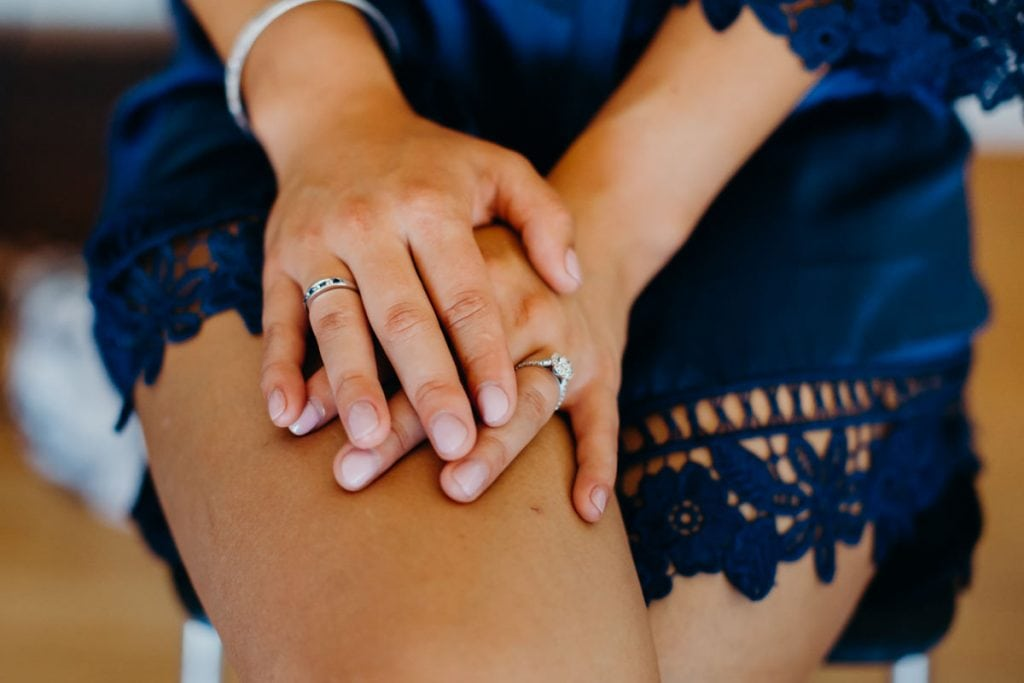 bride's hands with engagement ring
