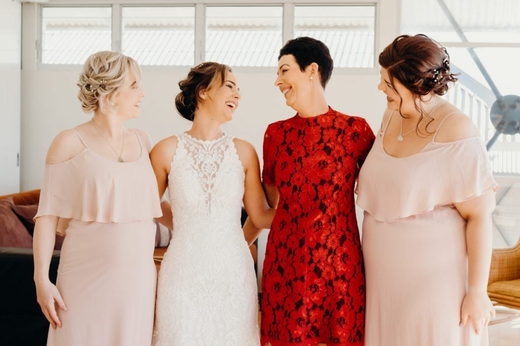 group photo of bride with bridesmaids and mother