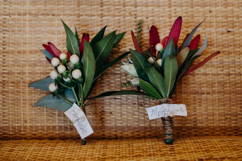 flower buttonholes for father and mother