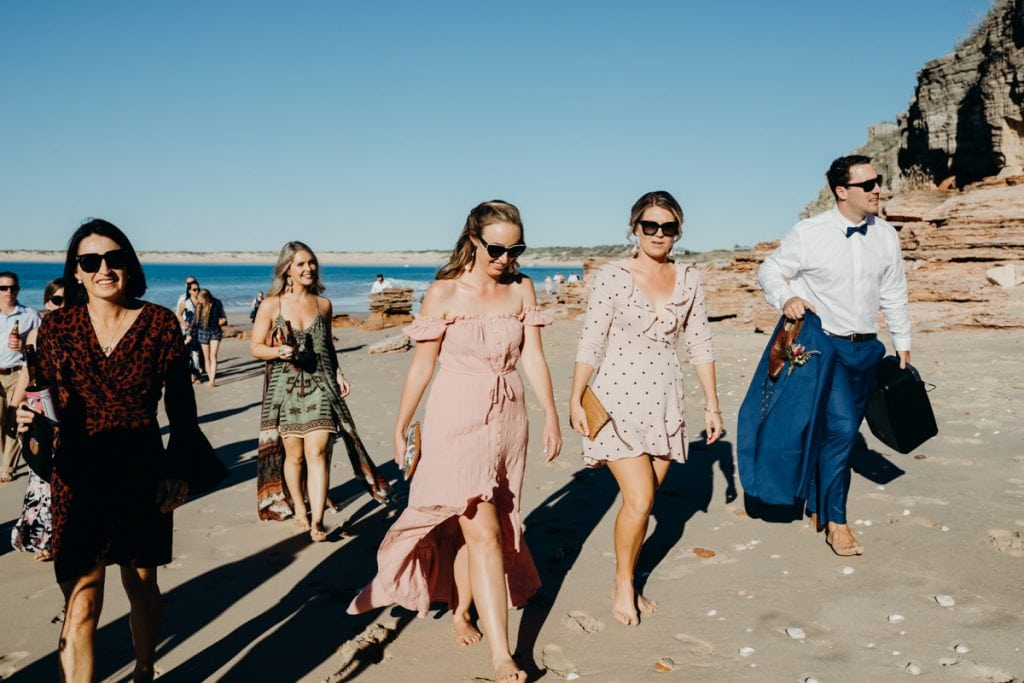wedding guests barefoot on Eco Beach